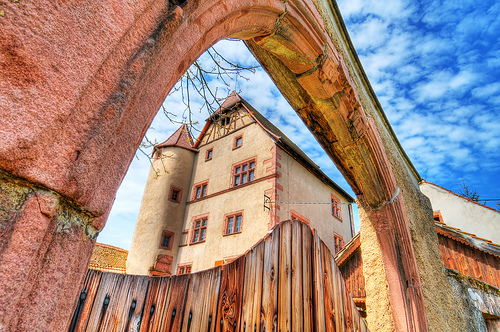 Walbach castle as seen through a stonr arch